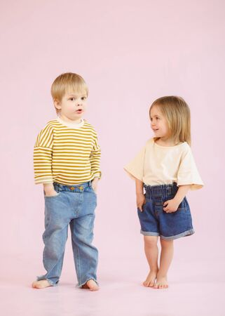 studio portrait of a boy and a girl
