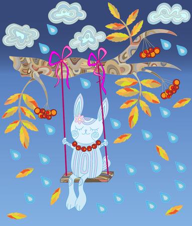 rowan tree: Bunny swinging on a swing on a branch of rowan tree in the rain and leaf fall