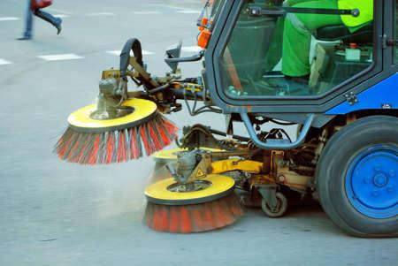machine cleaning dust from sidewalk            photo