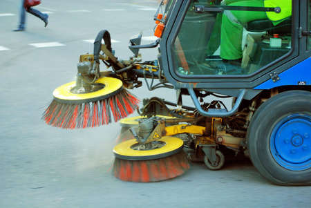 modernization: machine cleaning dust from sidewalk