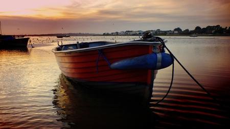 Bateaux au coucher du soleil sur Mudeford Quay