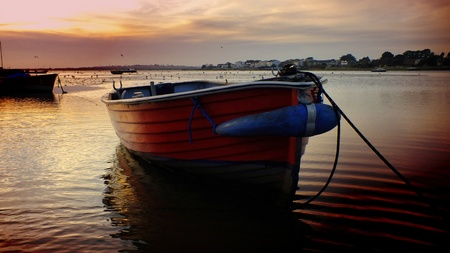 Boats at sunset on Mudeford Quay Stock Photo - 11744002