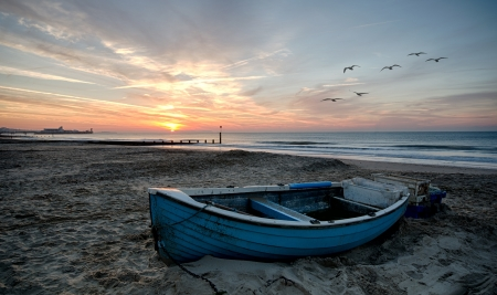 Fishing boats at Durley Chine with Bournemouth Pier in background Stock Photo - 16296310