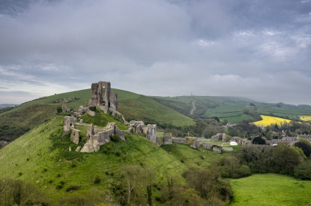 The ruins of Corfe Castle in Dorset on a blustery spring day photo