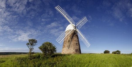 Panorama of Halnaker Windmill, a tile hung brick tower mill built in 1750  Stock Photo