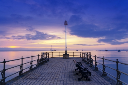 Sunrise at the Banjo Pier at Swanage Stock Photo - 16786928