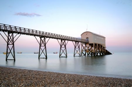 lifeboat station: Selsey Bill lifeboat station in West Sussex at sunset