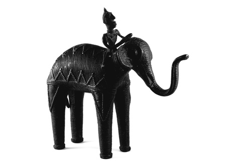 Dark bronze elephant statue with rider isolated on a white background.