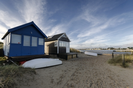Beach huts and boats in sand dunes at Mudeford Spit on Hengistbury Head near Christchurch in Dorset  Stock Photo - 16983716