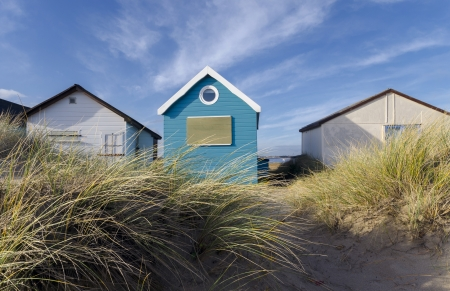 Beach huts in sand dunes at Mudeford Spit on Hengistbury Head near Christchurch in Dorset