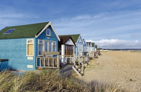 hengistbury head: Beach huts and boats in sand dunes at Mudeford Spit on Hengistbury Head near Christchurch in Dorset