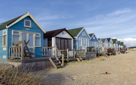 Beach huts in sand dunes at Mudeford Spit on Hengistbury Head near Christchurch in Dorset  photo