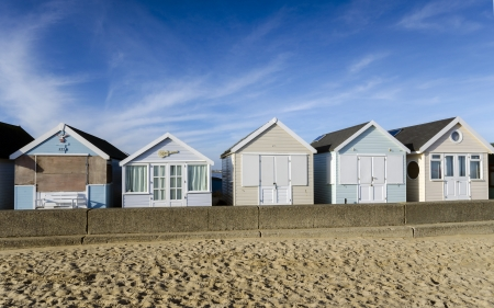 Row of brightly coloured beach huts at Hengistbury Head near Christchurch in Dorset  Stock Photo - 16983711