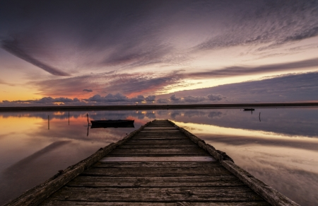 Sunset at a jetty on the Fleet Lagoon at Chesil Beach near Weymouth Stock Photo - 16974307