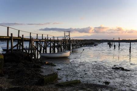 Sunset at a wooden jetty in Poole harbour photo