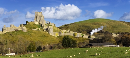 The ancient ruins of Corfe Castle near Swanage on the Isle of Purbeck in Dorset  Stock Photo
