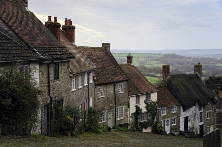 A row of cottages on a steep cobbled street at Gold Hill in Shafetsbury, Dorset Stock Photo - 17094427