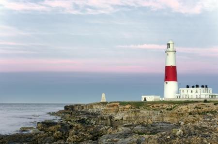 The lighthouse and obelisk at Portland Bill on the Jurassic Coast near Weymouth in Dorset Stock Photo - 17313907