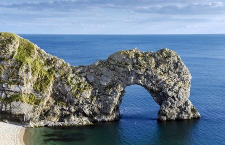 durdle door: Durdle Door a natural limestone arch on Dorset s Jurassic Coastline Stock Photo