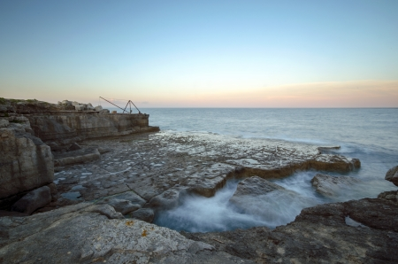 Rocky ledges and a boat winch on the cliffs at Portland Bill on the Jurassic coast in Dorset near Weymouth Stock Photo - 17391338