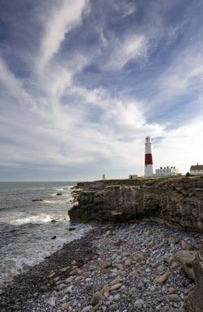 The lighthouse and obelisk at Portland Bill on the Jurassic Coast near Weymouth in Dorset Stock Photo - 17391336