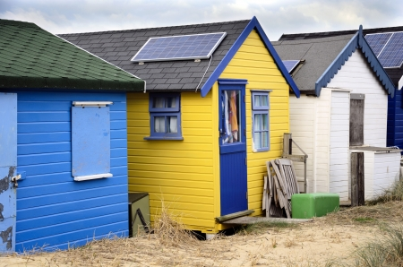 hengistbury: Brightly coloured beach huts with solar panels at Hengistbury Head near Bourenmouth