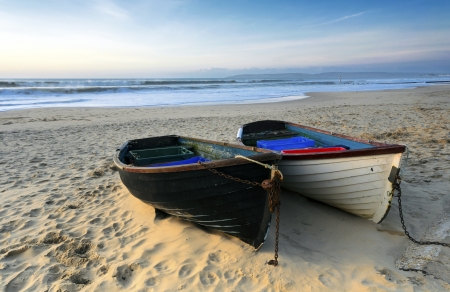 Fishing boats on a sandy beach in Bournemouth with Old harry rocks and the Isle of Purbeck in the distance Stock Photo - 17622204