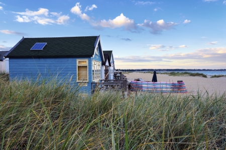 Beach huts in sand dunes at Mudeford Spit on Hengistbury Head near Bournemouth and Christchurch in Dorset  photo