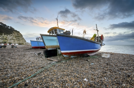Fishing boats at sunrise on the beach at Beer on  Devon photo