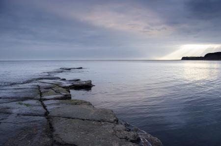Slate ledges revealed at low tide in Kimmeridge Bay on the Jurassic coastline of Dorset  Stock Photo - 18051024