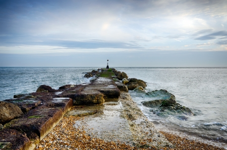 hengistbury: A long sea groyne on the beach at Hengistbury Head near Christchurch in Dorset Stock Photo