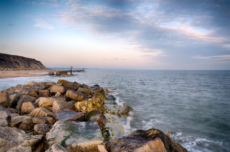 hengistbury: The beach and sea groynes at Hengistbury Head near Christchurch in Dorset