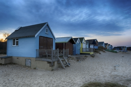 Beach huts on Mudeford Spit at Hengistbury Head near Christchurch just after sunset