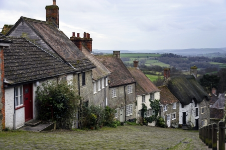 A row of cottages on a steep cobbled street at Gold Hill in Shafetsbury, Dorset photo