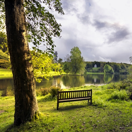 english west country: A bench overlooking the lake at Stourhead