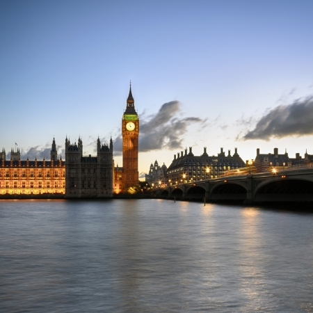 Westminster Bridge in London with Big Ben and the houses of parliament. photo