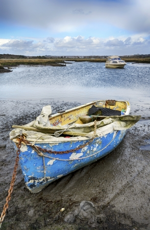 Old boat moored in Upton Lake in the back waters of Poole Harbour in Dorset photo