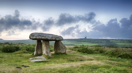 Lanyon Quoit near Madron on the Lands End Peninsula in Cornwall, with a Cornish tin mine in the distance