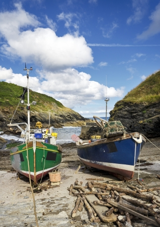 Colourful fishing boats on the beach at Portlooe a small fishing village on the south coast of Cornwall photo