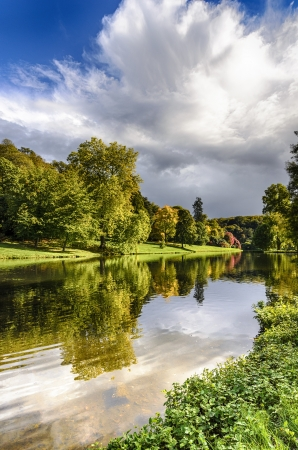 wiltshire: Autumn reflections in the lake at Stourhead in Wiltshire