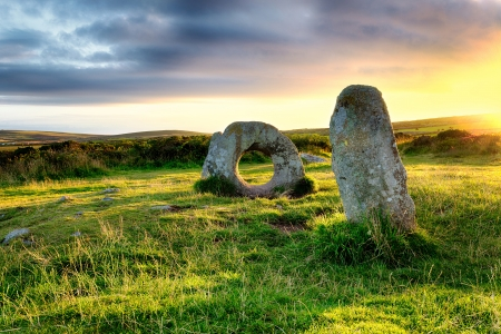 The Men-an-Tol standing stones Near Penzance in Cornwall, local legend says that a person passing through the holed stone can cure many ailments including infertility photo