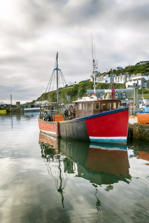 Old wooden fishing boat moored in Mevagissey harbour in Cornwall Stock Photo