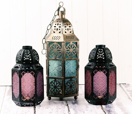 multicolor lantern: Three glass and metal lanterns