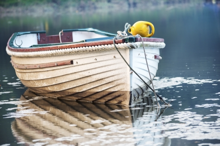 A boat moored on the Lerryn River in Cornwall photo