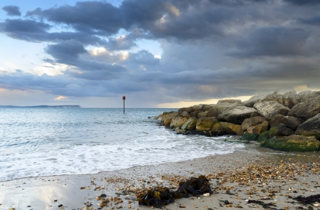 hengistbury: The beach at Hengistbury Head near Christchurch in Dorset with the Isle Of White in the distance