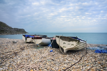 Fishing boats on the beach at Chesil Cove on Portland near Weymouth in Dorset