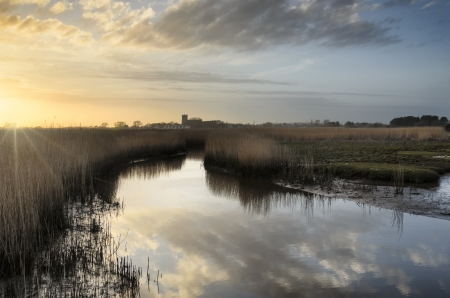 priory: Looking out across Stanpit Marsh towards the priory at Christchurch in Dorset Stock Photo