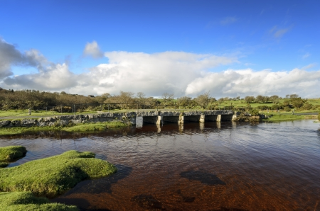 Delphi clapper bridge crossing the De Lank River near St Breward on Bodmin moor in Cornwall photo