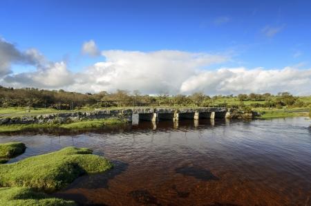 bodmin: Delphi clapper bridge crossing the De Lank River near St Breward on Bodmin moor in Cornwall