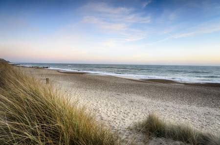 hengistbury: Sunset over sand dunes at Hengistbury Head beach near Christchurch in dorset Stock Photo